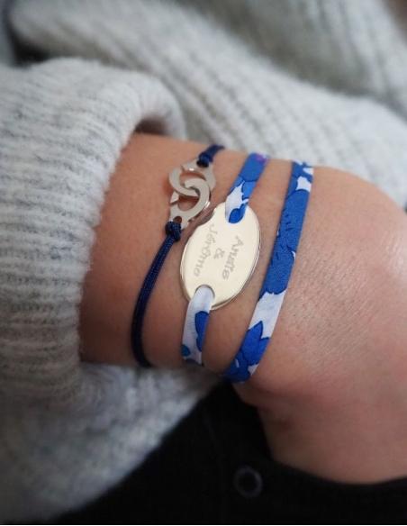 Bracelet menotte sur cordon bleu